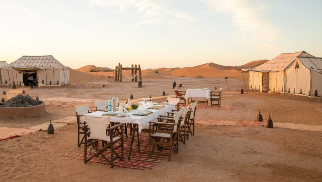 Breakfast at sunrise in the Moroccan desert