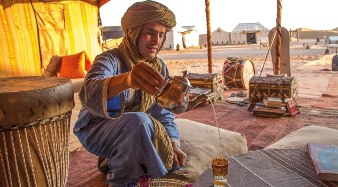 Pouring tea in the Middle Eastern desert