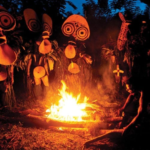 Tribe around a fire in Papua New Guinea