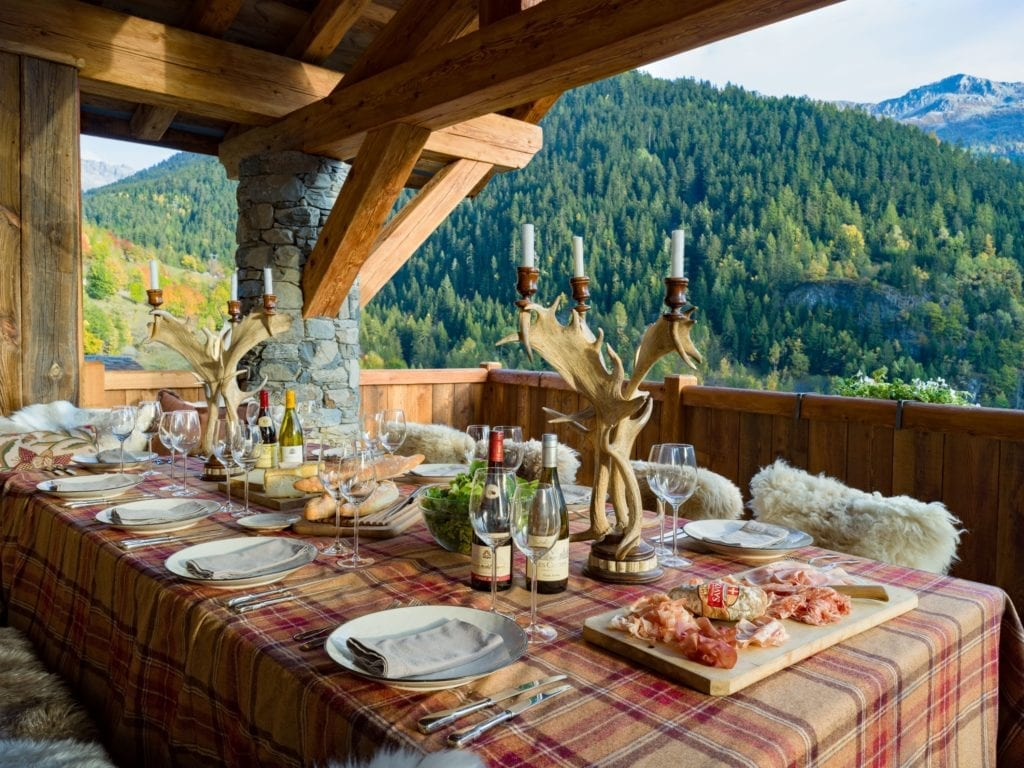 Balcony Dining Area with Mountain Views at Chalet Hibou The Alps France