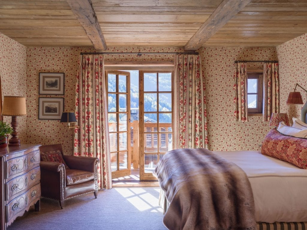 Bedroom Interior with Mountain Views at Chalet Hibou The Alps France