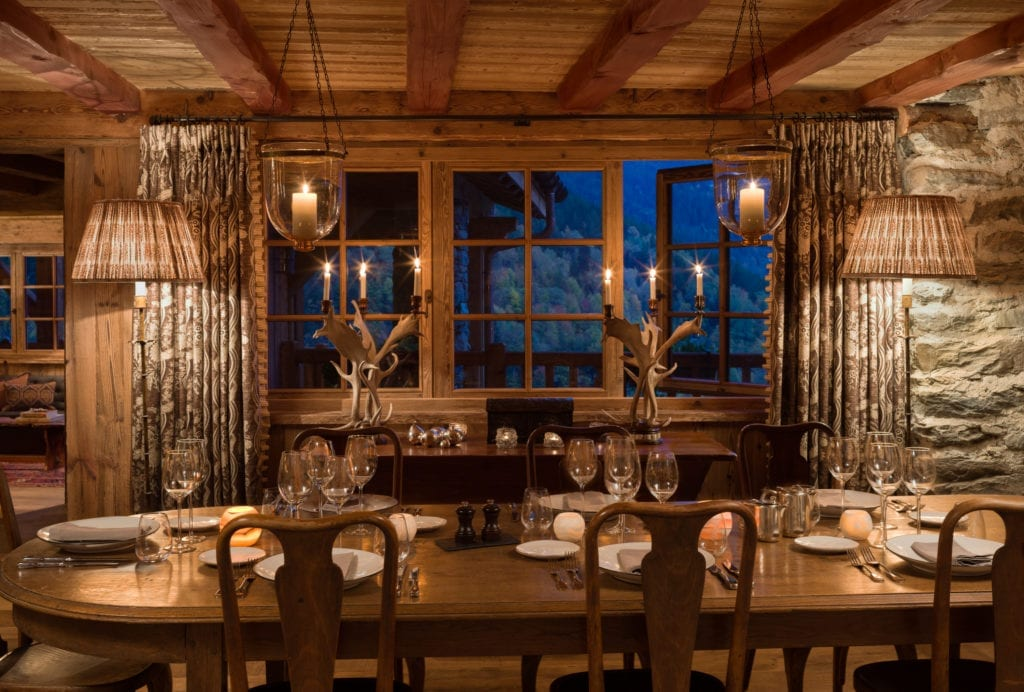 Dining Area at Night at Chalet Hibou The Alps France