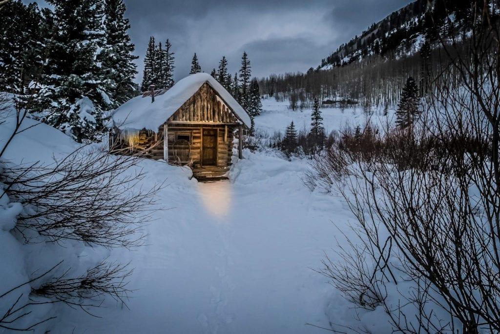Dolores Cabin Exterior in Winter Snow at Dunton Hot Springs Colorado USA