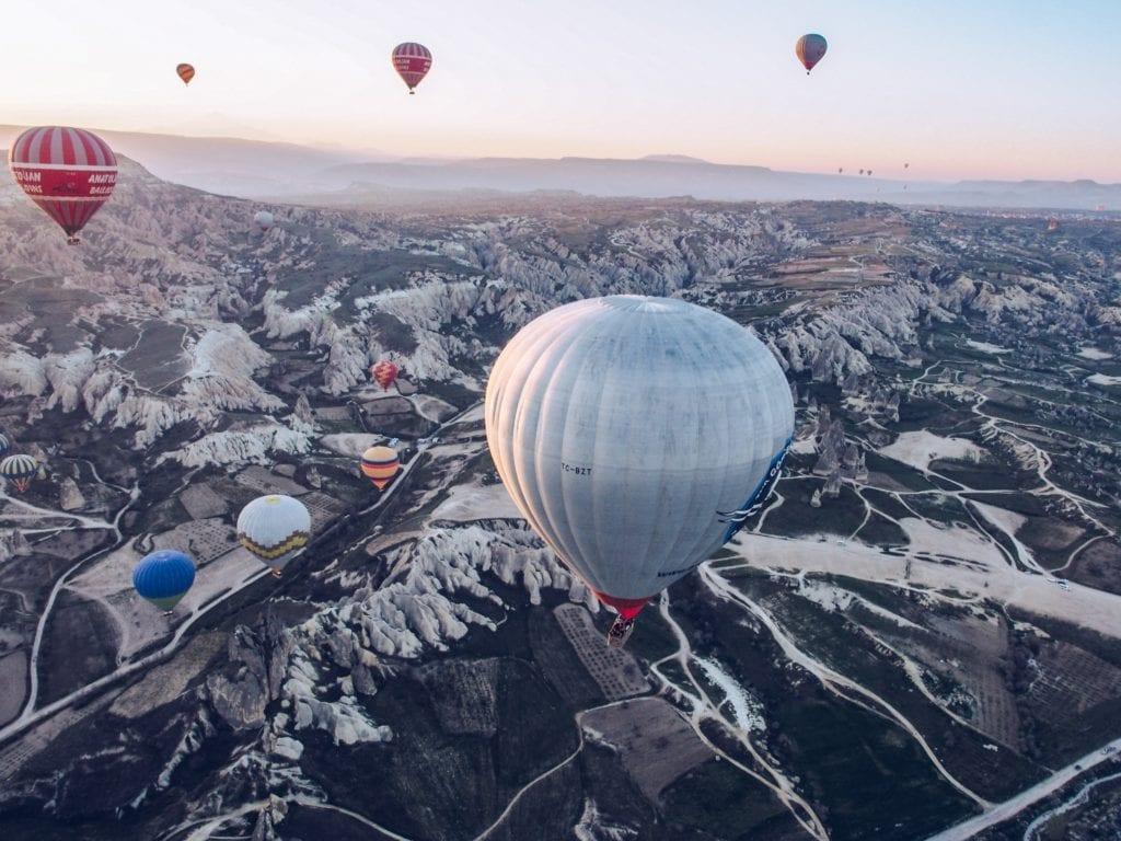 Hot Air Balloons over Snow in Cappadocia Turkey