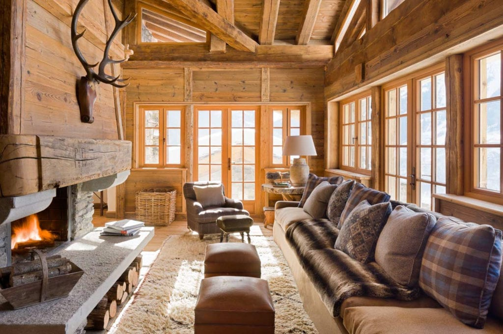 Interior Seating and Lounge Area with Fireplace at Chalet Pelerin, Alps, France