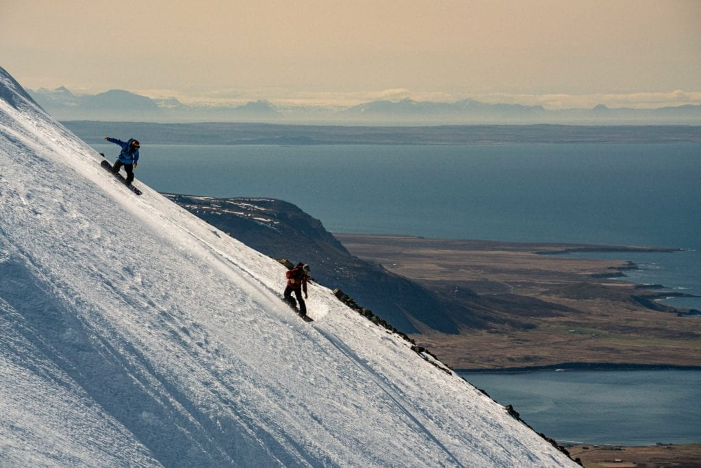 Skiing Sheer Coastal Cliifs and Mountains in Iceland at Dusk