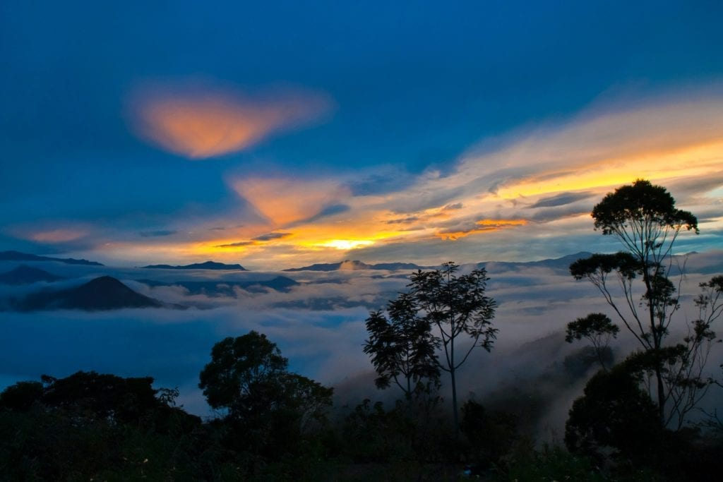 Sunset over the Mist Shrouded Mountains of Ecuador at Sunset