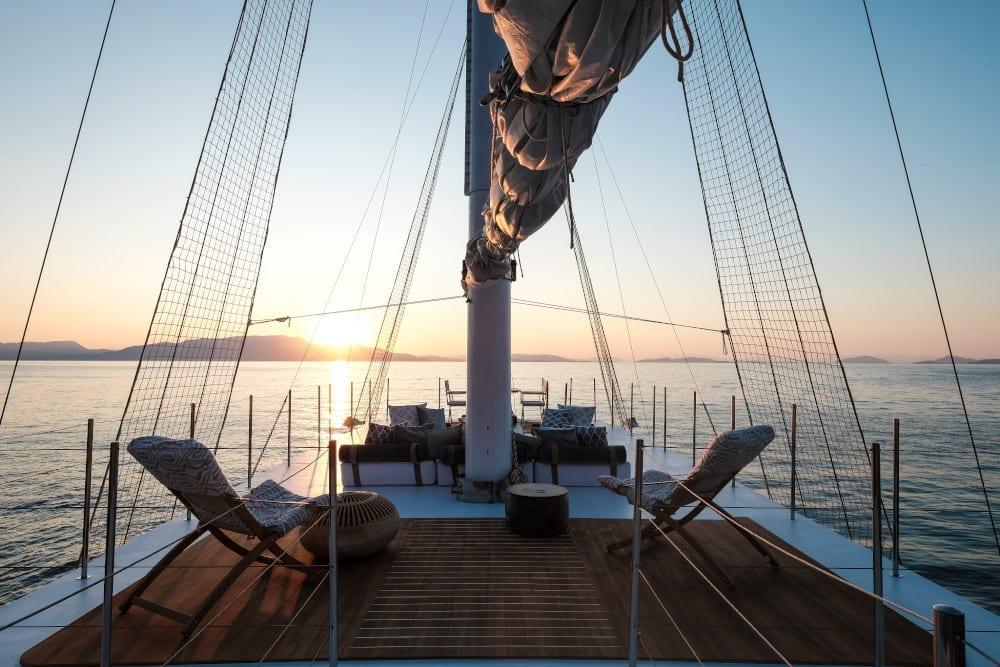Upper deck of Alexa J during sunrise