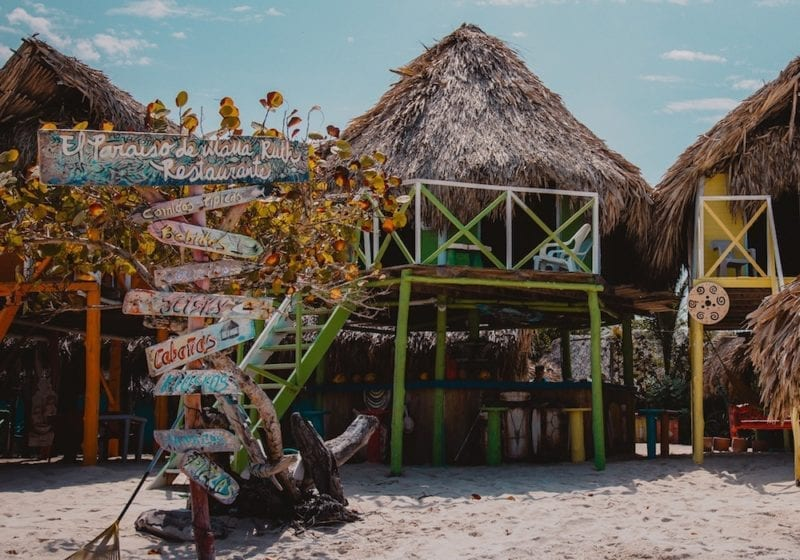 Beach shacks and beach signs in Colombia