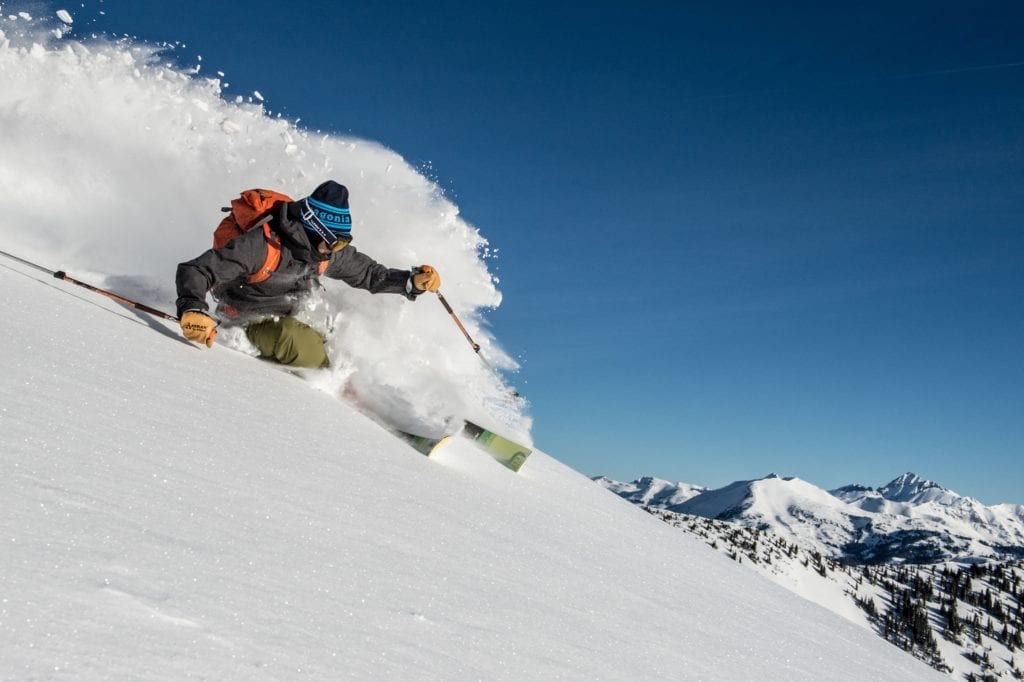 Colorado Cat Skiing Carving Powder Down a Mountain USA
