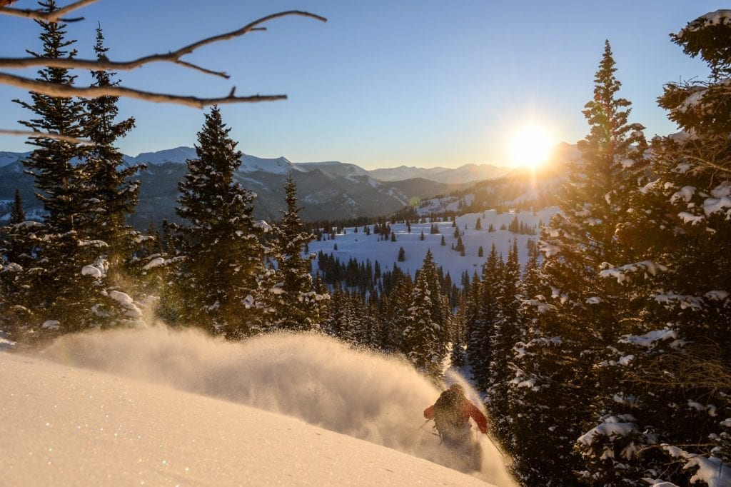 Colorado Sunrise Cat Skiing through the Forest USA