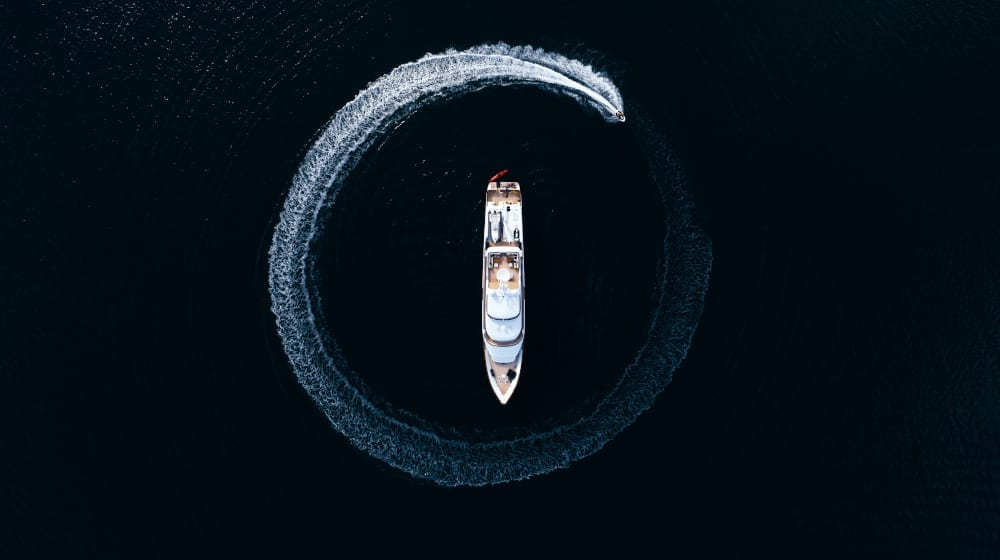 Drone image of Daydream and a speedboat