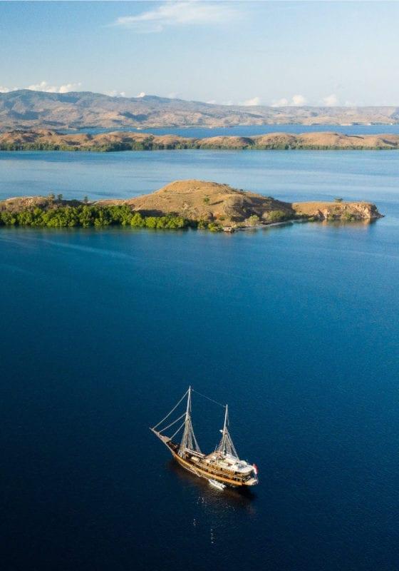 Dunia Baru yacht sailing near islands