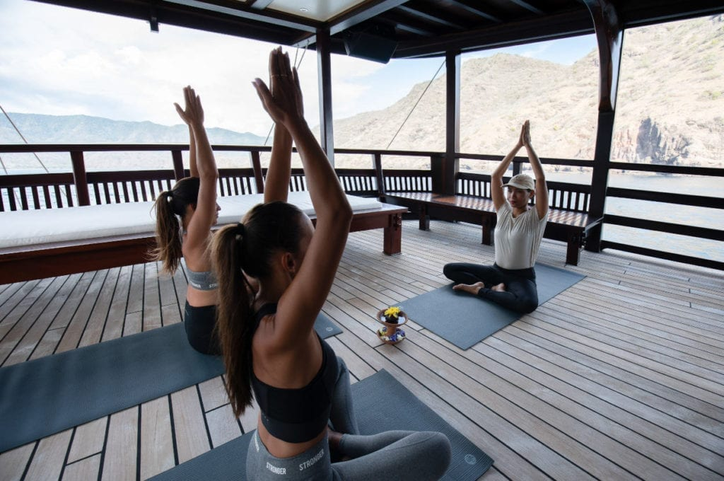 Yoga class on the deck of the Dunia Baru