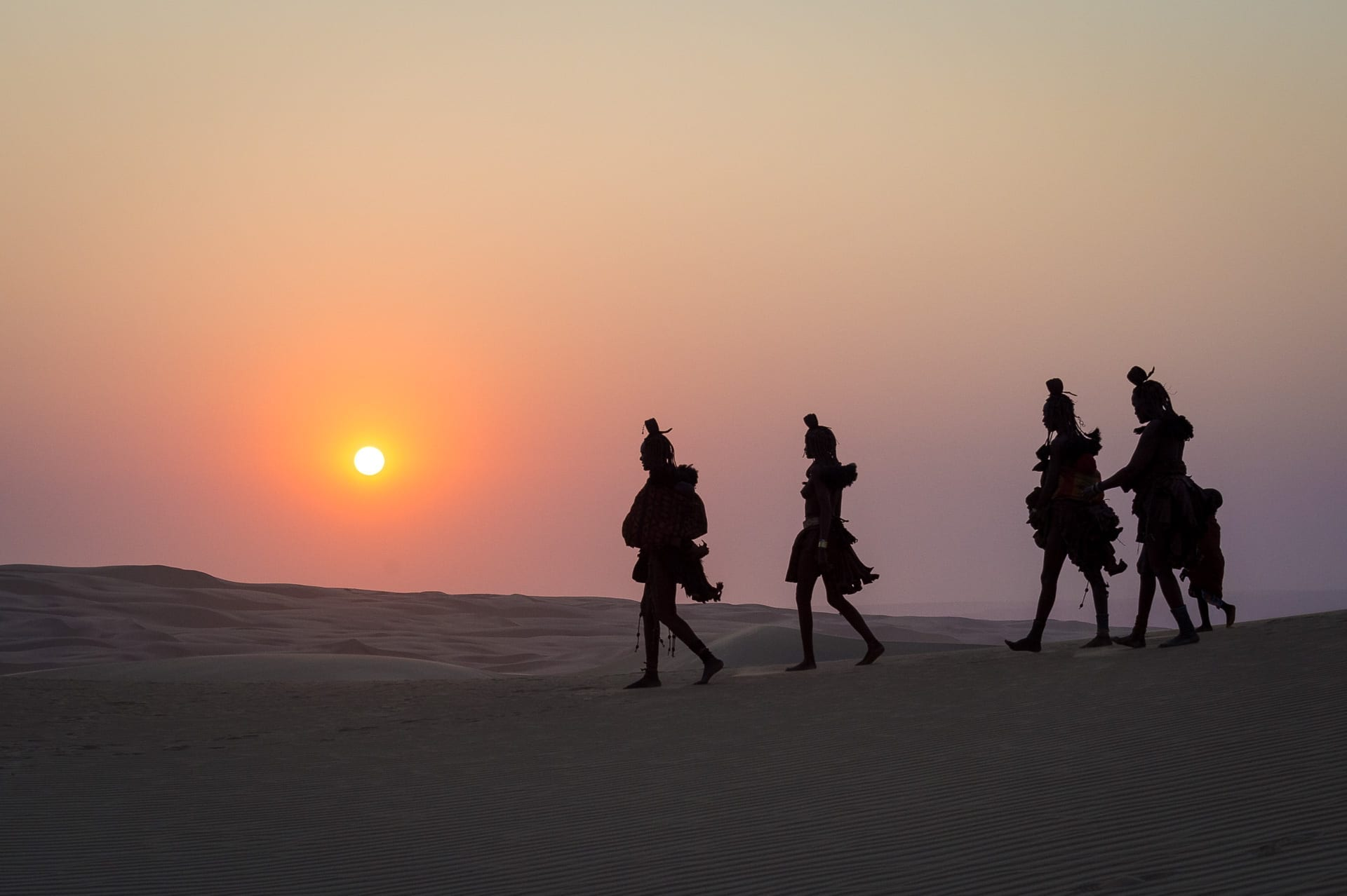 semi-nomadic Himba people silhouette in the sunset