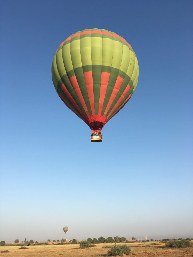 floating above the desert in a hot air balloon