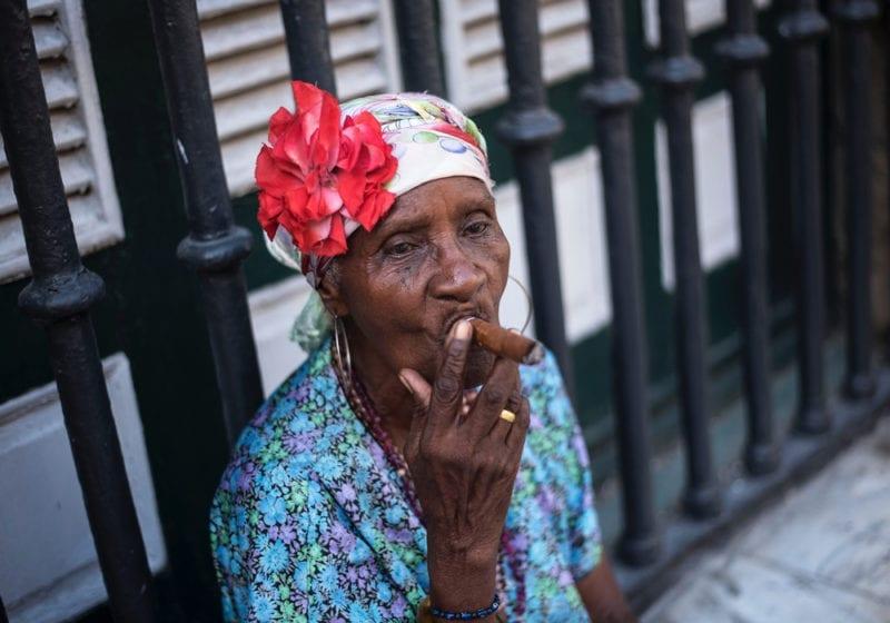 Woman Smoking a Cigar in Cuba