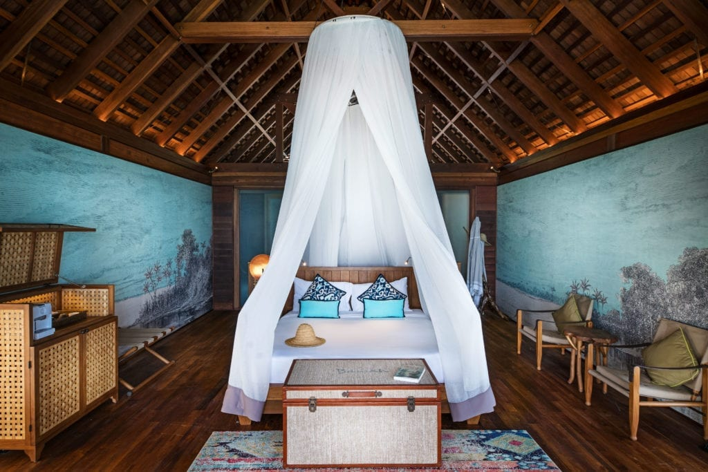 Overwater Suite Bed Canopy Interior Bawah Reserve Indonesia