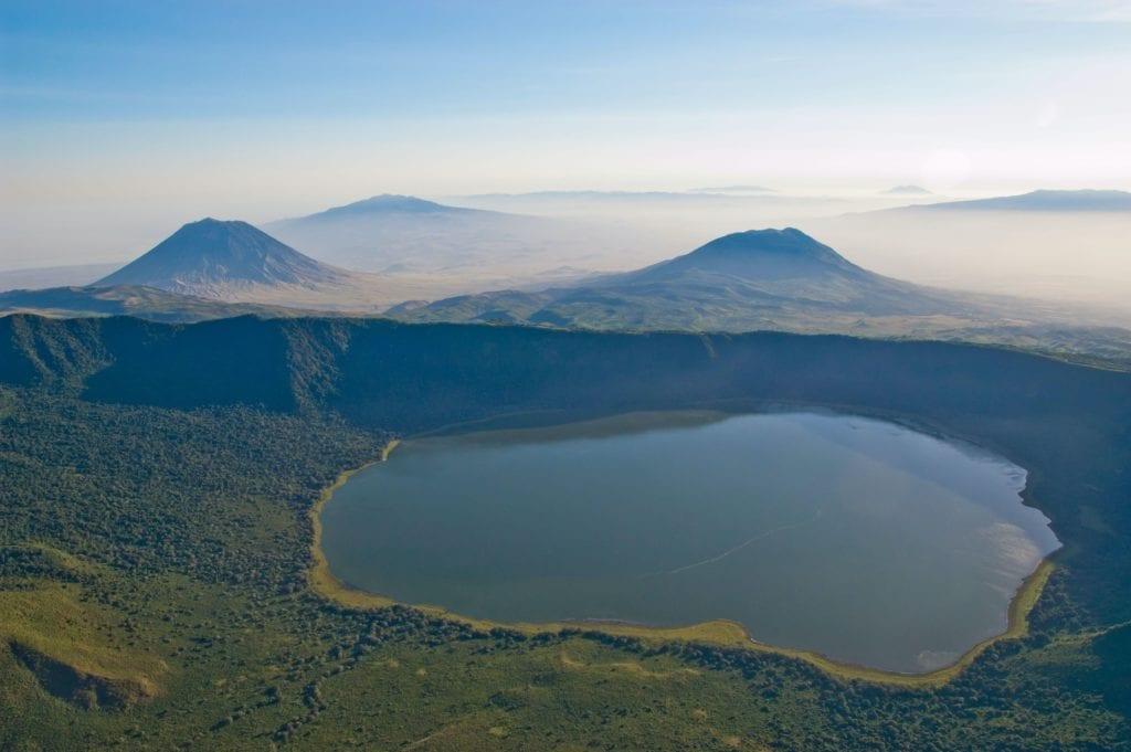 Empakai crater and lake, in the background Ol Doinyo Lengai (left) and Keremasi (right), Tanzania
