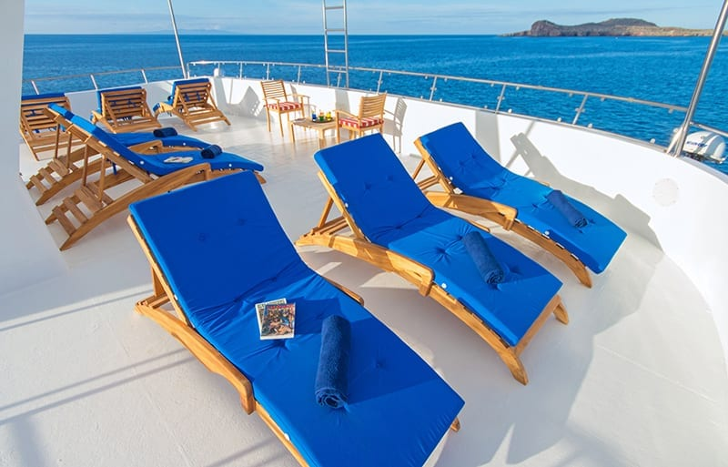 Sun loungers on the deck of Tip Top II