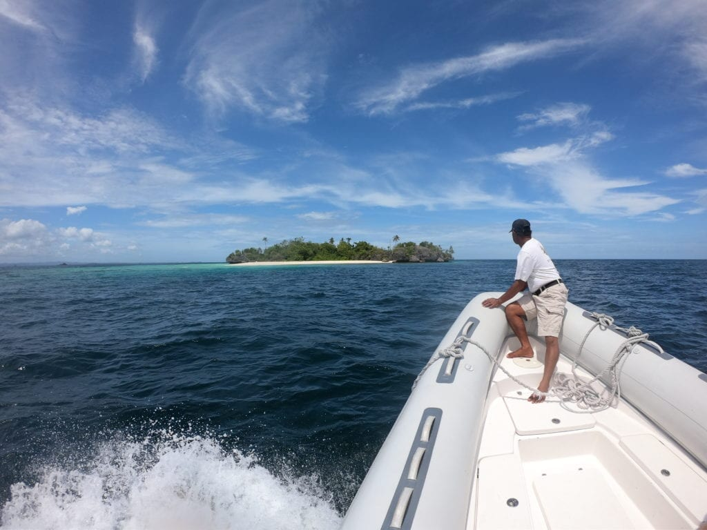 approaching desert island by tender to Dunia Baru
