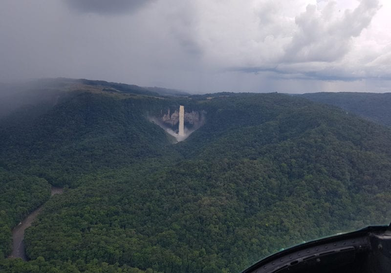 Heli over jungle and waterfalls in Guyana