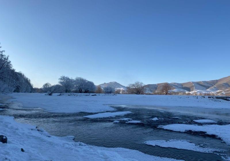 Snowy river scene Mongolia