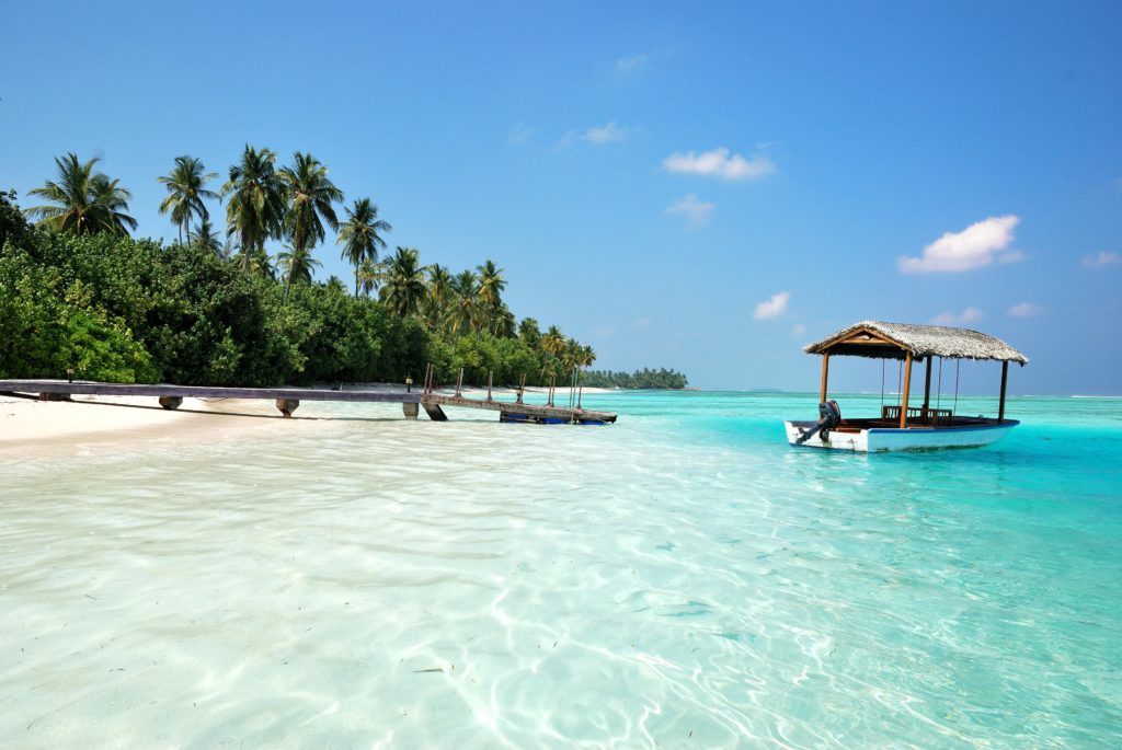 Boats in The Shallows of Beach in the Maldives