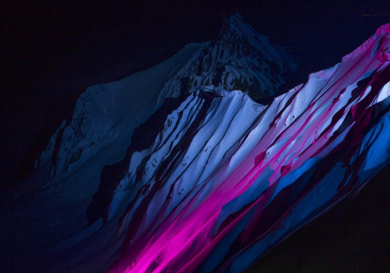 Mountain lit up for night skiing in British Colombia, Canada