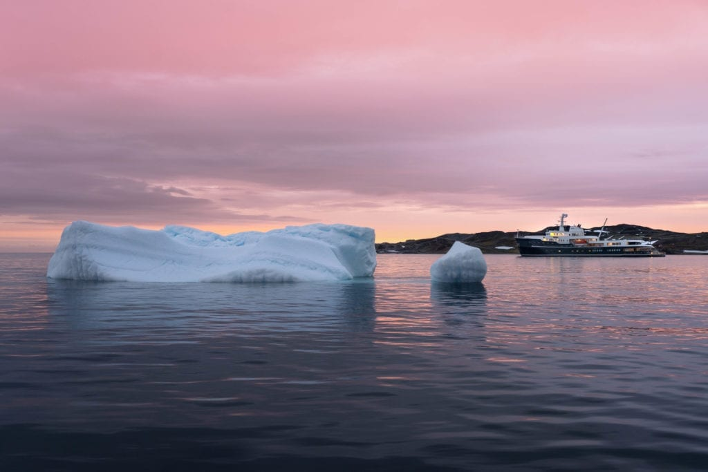 pink sky reflection antarctica vessel
