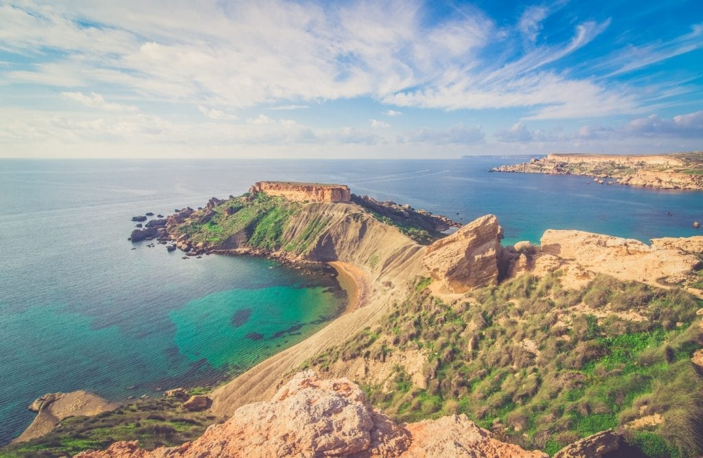 the azure waters of Malta's coastline