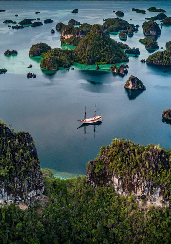 Aerial View of Silolona Yacht Among Indonesian Islands