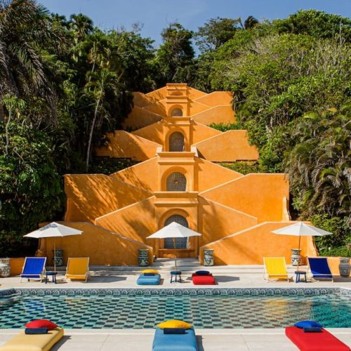 The beautifully colourful pool of the chic beach resort Cuixmala, Mexico