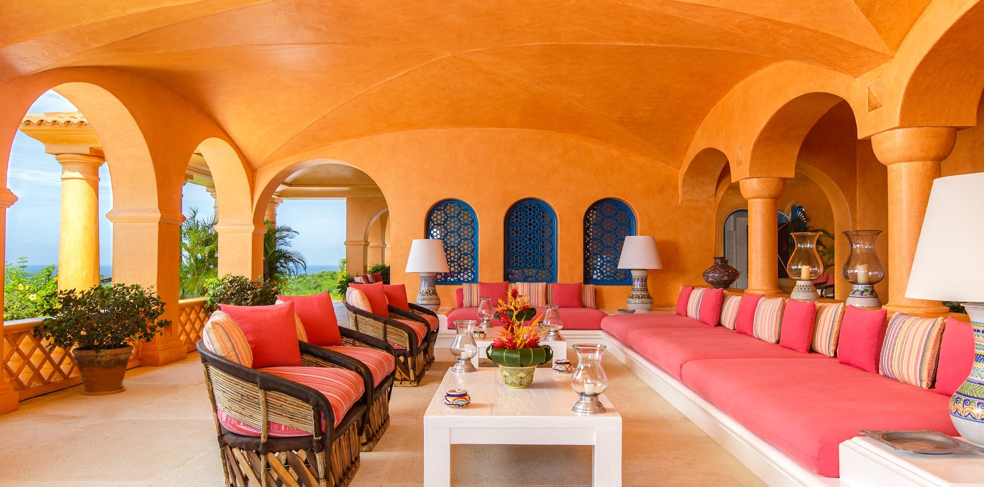 Orange washed walls of Cuixmala Mexico beach resort seating area