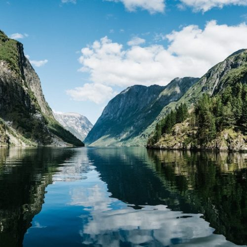 Hero Image Norwegian Fjords and Mountain Reflections