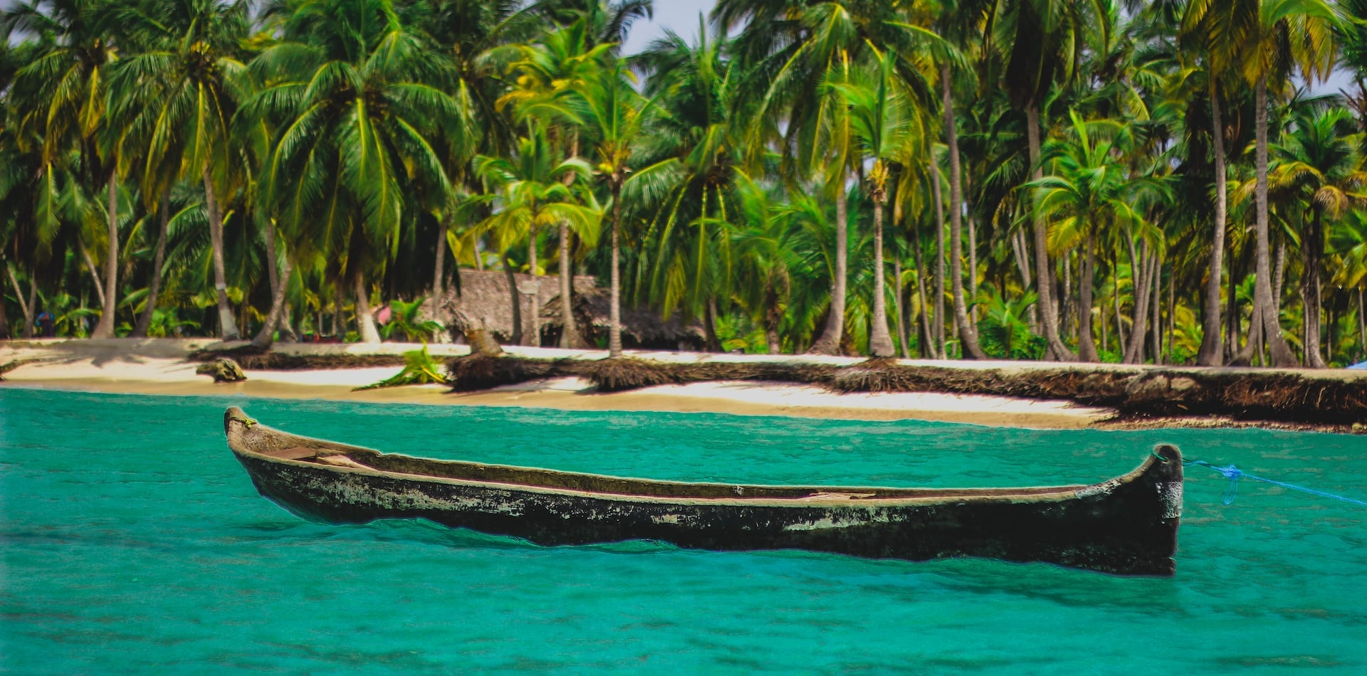 Authentic longboat floating in Panama's pristine warm waters