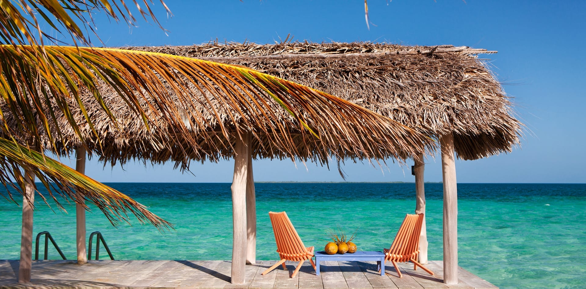 Secluded and shaded. thatched seating area at Royal Belize