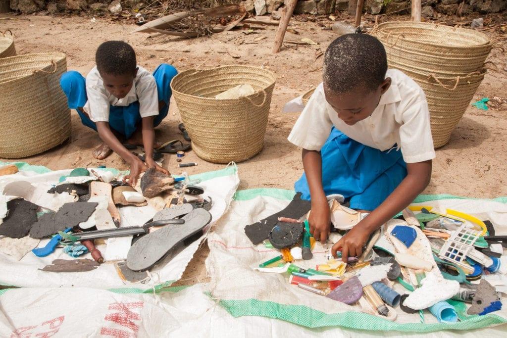 local kenyan children sorting beach waste