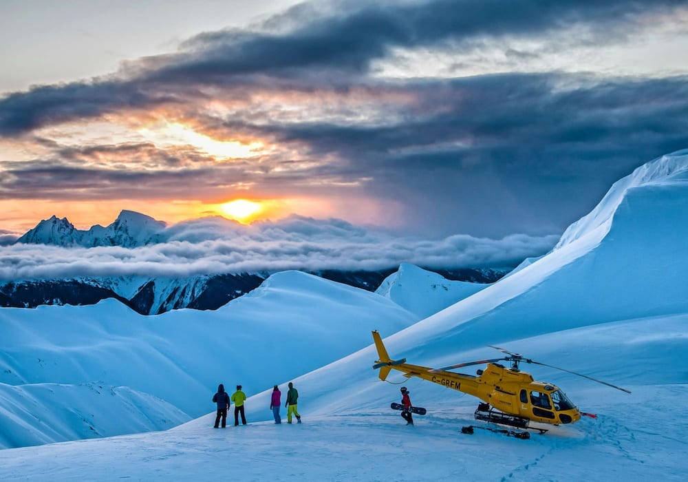 reaching new heights by helicopter to see sunrise and ski fresh powder