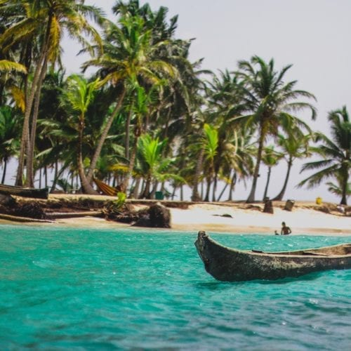 San Blas Islands Native Canoes and Palm Trees in Panama