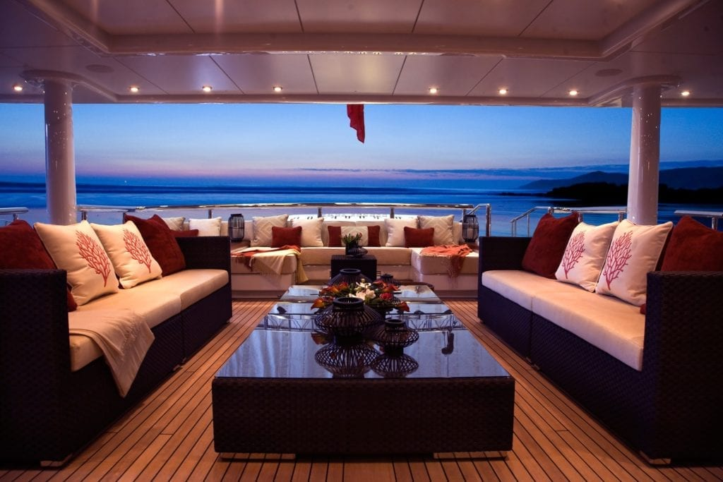 SuperYacht Sea Rhapsody's deck seating at sunset