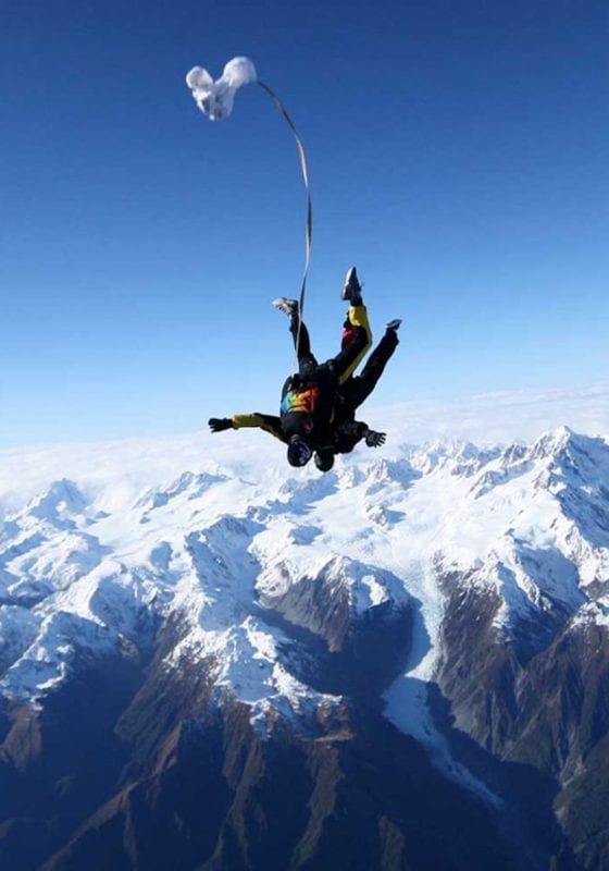 adrenaline-spiking activity of sky diving with view over snowcapped mountains in Alaska