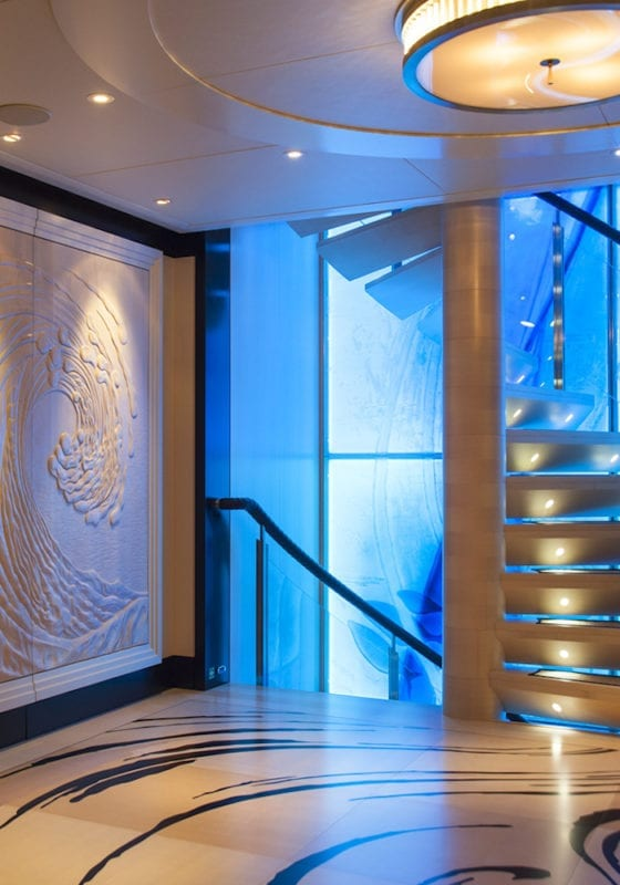 modern yacht interior and lit up spiral staircase, interior of Sea Rhapsody