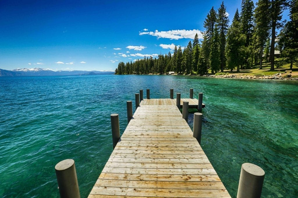 Jetty out into a pristine lake in Sugar Pine Point, California USA Wilderness Adventure