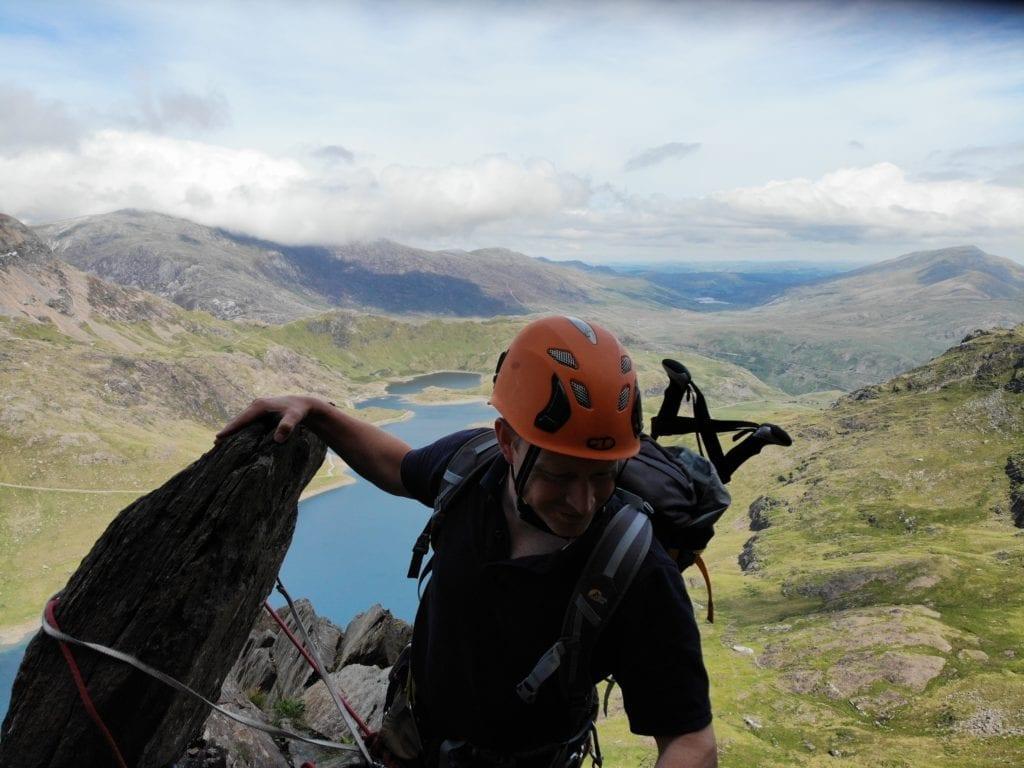 Climbing in Wales with beautiful lake backdrop, UK