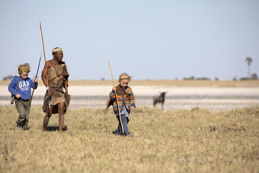 Children walking with the bushmen on a family wildlife experience