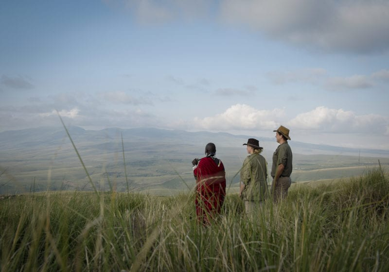 Guests with Maasai warrior guide from The Highlands camp, Tanzania, Africa