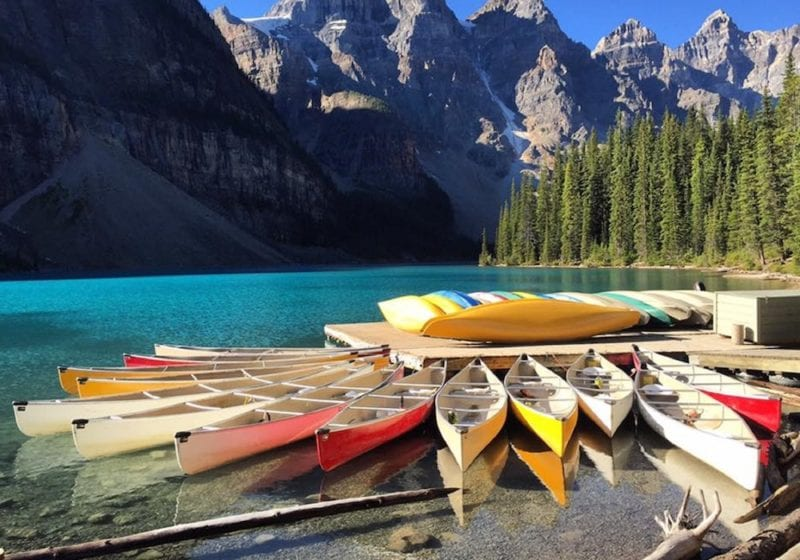 colourful canoes on an alpine lake in Canada