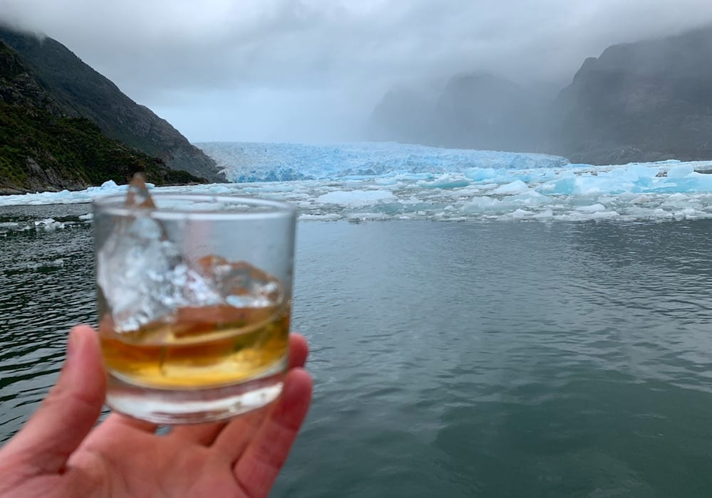 Charlie enjoying a whiskey cooled by ice by the glacier