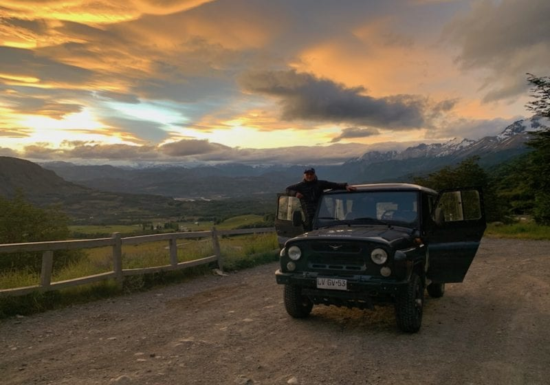 Chile, Parque Nacional Cerro Castillo, Charlie watching sunset from car